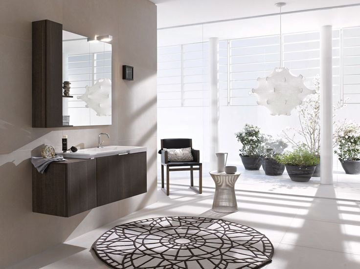 FLY 107 - Tranchè Terra. Integrated countertop Comet 81 mineral marble.