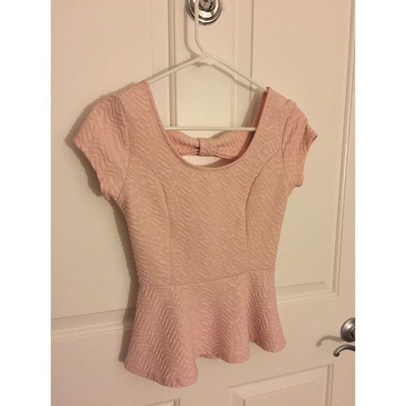 Moving Sale!! Pink Peplum Top Moving sale!! All items must go or will be donated at the beginning of next month!!Taking any and all offers!!! Willing to do deep discounts for bundles☺️  Light pink peplum top. Never been worn, just not my style. Charlotte Russe Tops