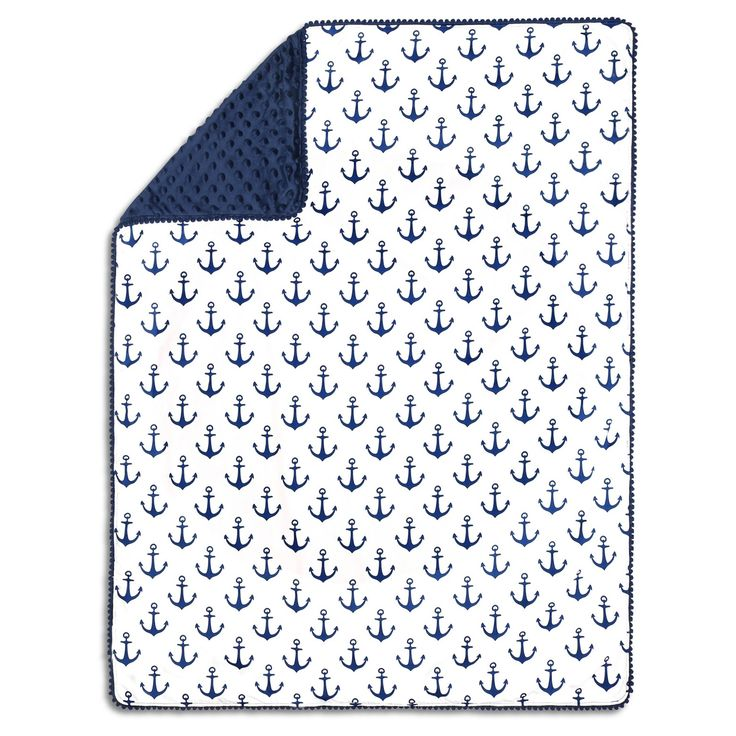 As cozy as it is cute, the Navy Anchor Pompom Blanket by The Peanutshell features a soft 100% cotton sateen print on one side with a buttery soft plush dot on the other. The classic navy anchor pattern reverses to a navy minky dot with pompom trim. Perfect for a cuddle at home or wherever your day may take you.