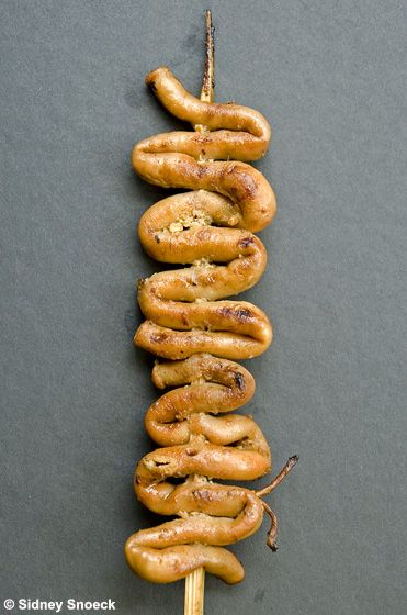 Isaw is a street food that is a chickens small intestine ...