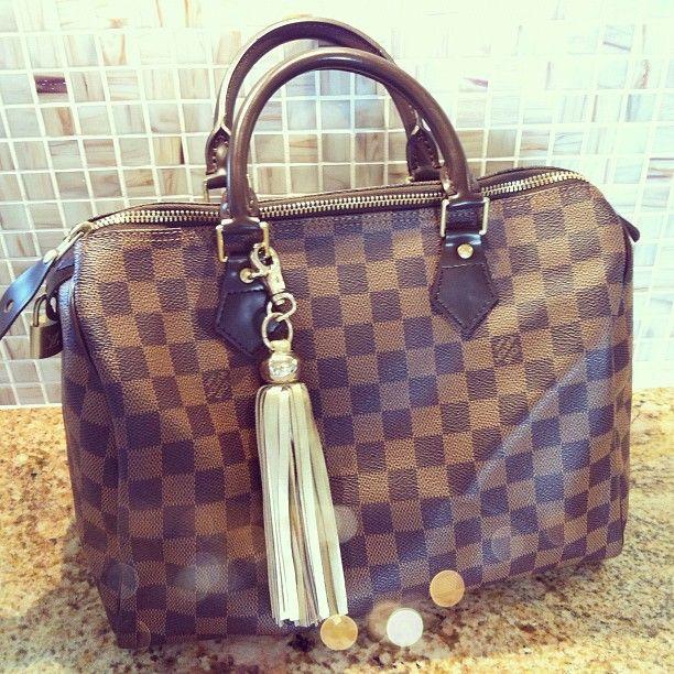I love this tassel on the LV bag