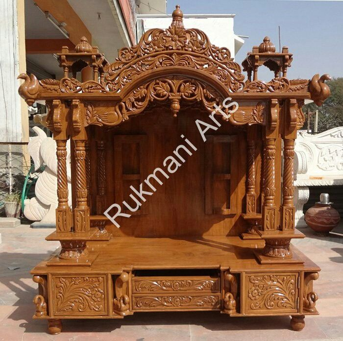A traditional teak wood mandir.