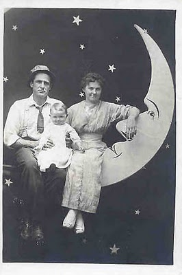 family with happy baby, paper moon
