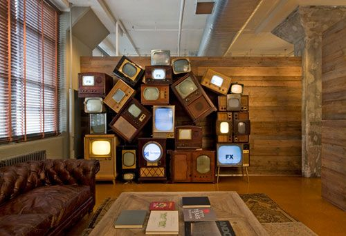 Designed by architect Jill Diamant of DHD Architecture and Design, the Media Storm offices scream creativity which is just what an advertising agency needs. Green was the name of the game with the use of reclaimed wood siding from an old barn, re-purposed theater seats, a wall of salvaged TVs, and various other eco-friendly items and finishes throughout.Dreams Home, Offices Spaces, Tv Wall, Interiors Design, David Howell, Dhd Architecture, Media Storms, Vintage Tvs, Old Barns