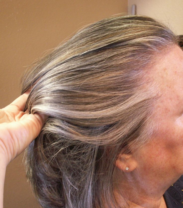 Lowlights and highlights added to grey hair. Hair by Janet - The Soteco Rhodes Salon