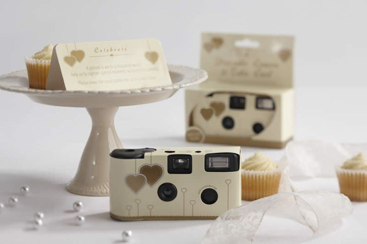 A picture's worth a thousand words! Use these ivory and gold, heart design, disposable, single use cameras to capture special moments. Each camera comes with a built in flash, a 27 exposure film and matching table card.