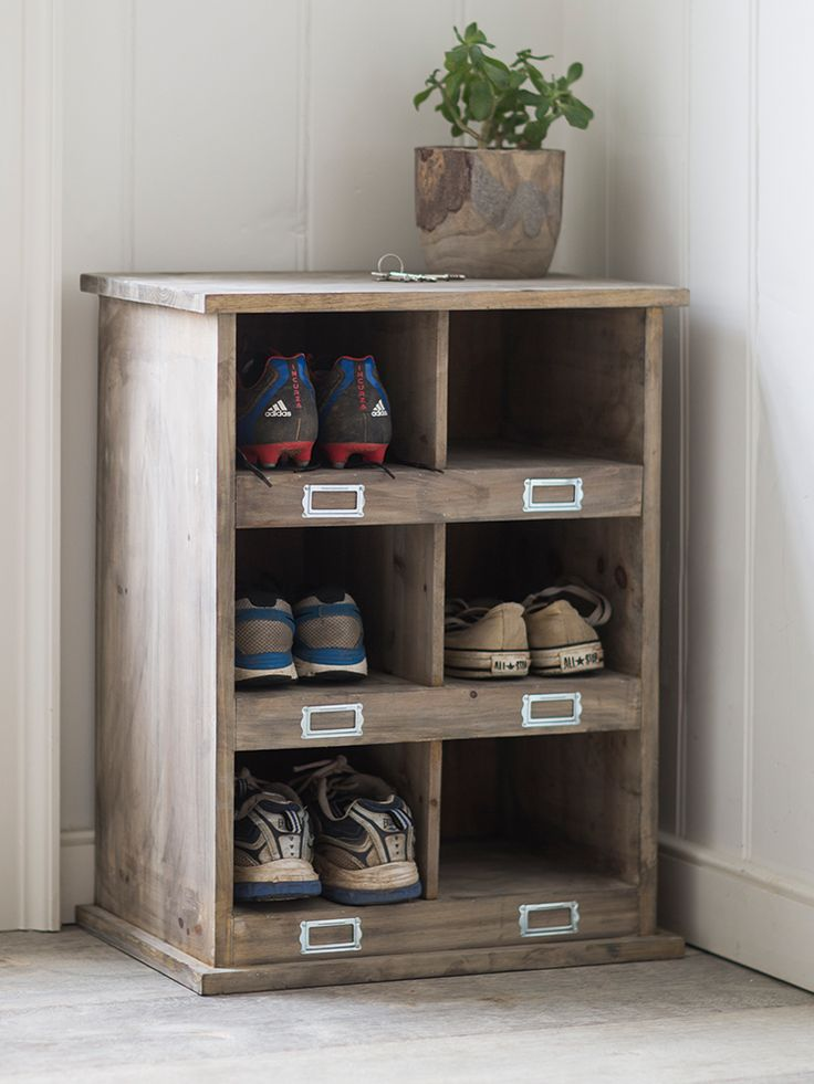 £155 Made from hand select fir wood that is both robust and hardwearing, our Small Wooden Box Unit is inspired by old fashioned shoe lockers and complements our bestselling Low Wooden Box Unit. Perfect for smaller spaces and narrow hallways, each unit includes six cubby holes with metal-framed label slots; great for giving shoes and clutter a new home. Why not as a cushion to the top and transform into a handy seat for changing your shoes?