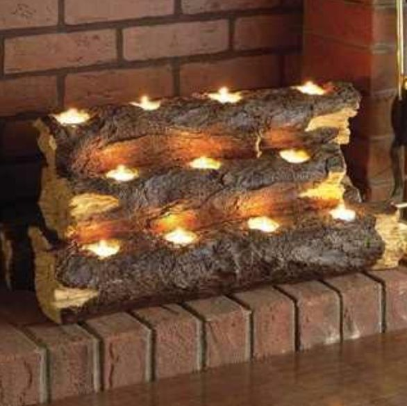 Use a coring wood bit to drill holes in logs then place tea light candles in votive size candle holders and light up a fireplace or special area. Best in the summer instead of a real fire that produces more heat.