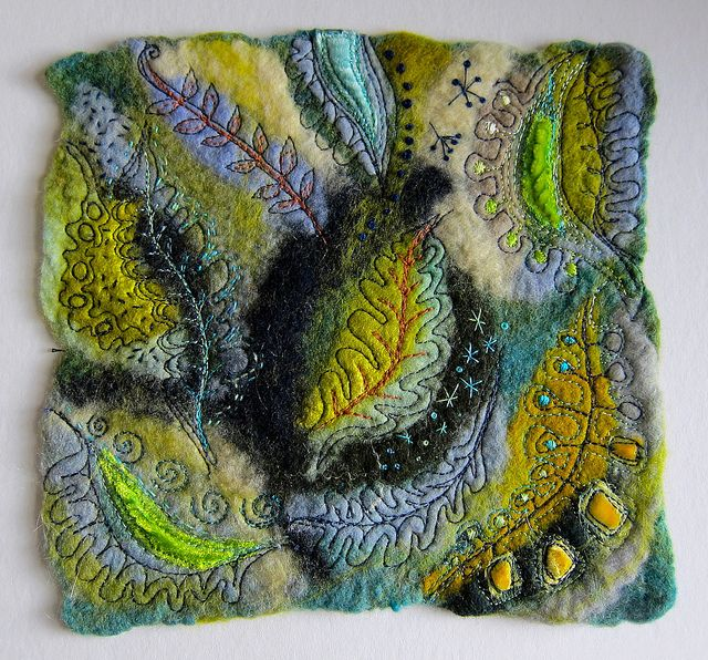 Textile art by Jackie Cardy.  Swirly leaves and stars on felt.