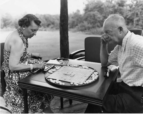 Ike and Mamie Play a Game of Scrabble  President and Mrs. Eisenhower play a game of Scrabble during a weekend vacation at Camp David, Maryland. 7/30/54.