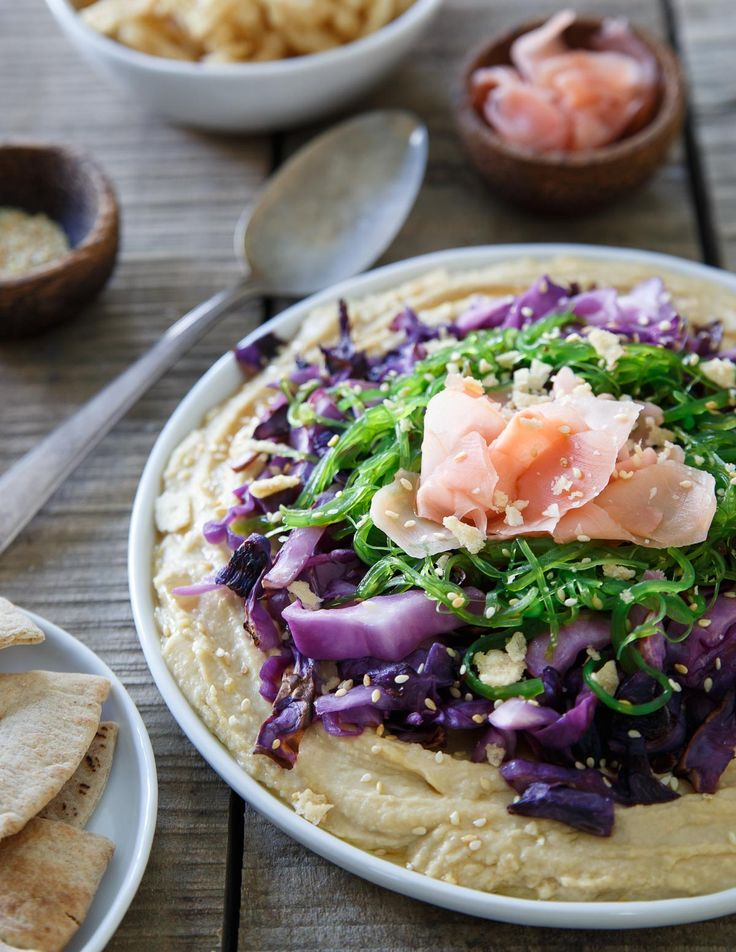 This Asian hummus platter topped with sesame cabbage, seaweed salad and pickled ginger is one tasty way to amp up your appetizer game.