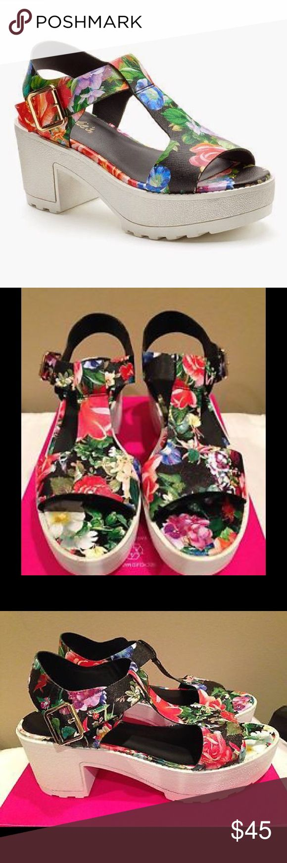 """Candie's Black Floral Platform Sandals NWT Candie's black floral platform sandals will add fun fabulous style to your wardrobe! They are perfect for the beach or on the city streets! * Upper/lining/outer sole: Man made * Padded foot bed and heal bed * Silver-tone adjustable buckle * Platform w/block heel *1"""" platform/2 3/4"""" heel height  *Bundle Discounts * No Trades * Smoke free Candie's Shoes Sandals"""