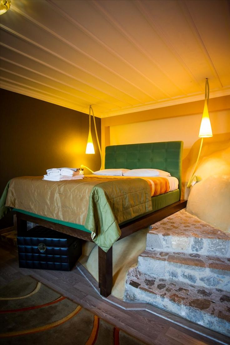 superior room PEGASOS raised double bed on a natural rock!!