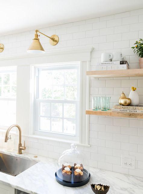 www.jennifercavorsidesign.com white subway tile / brass light fixture / brass faucet / marble countertop / floating shelves Photography by @jessica