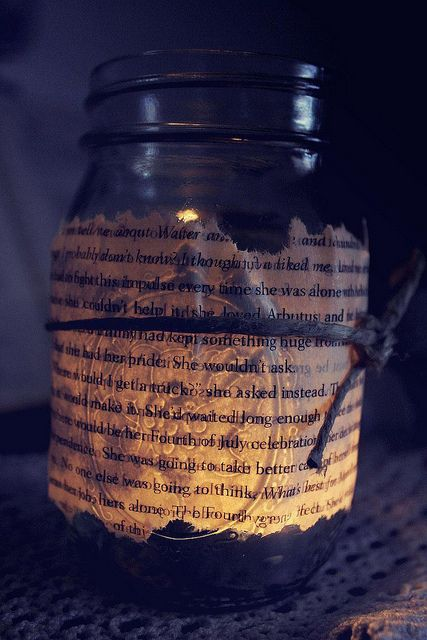 Book page jars with candle inside.  Love this!