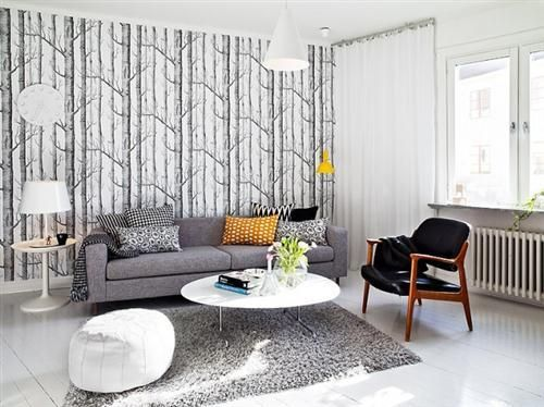 Grey and white living space, love the feature wall and moroccan pouffe