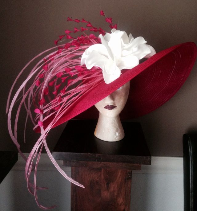 Hot pink Kentucky derby hat!  Eye catcher and def one of a kind.  Contact me if interested!  Janametc@bellsouth.net or janashatbox.com