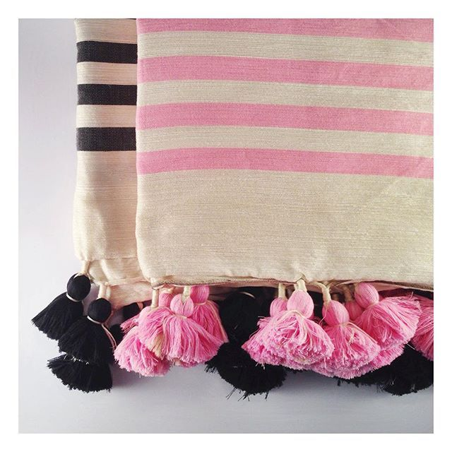 Making soft pink sophisticated  our stunning Pom Pom blankets hand woven by the talented artisans from the mountain villages of Tameslouht Morocco. Remember every purchase makes a difference  click through to zarparinteriors.com #globalliving #interiordecor #homewares #throws #pompomblanket #weddingdecor #nurseryinspo #weddinginspo #bohemian #stripes #pinkandblack #morocco