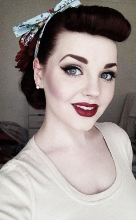 Vintage makeup pale skin tone . Minimal contour . Gorgeous flick eyeliner , bold brows . Rose red lips