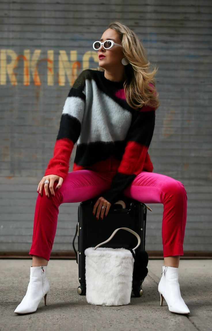 d2ef2488770d5 What To Pack For A Ski Trip // Black red white color block sweater, hot pink  velvet skinny pants, white heeled pointy toe booties, white oval sunglasses,  ...
