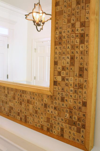 Inspirational sayings fill this custom scrabble mirror in the foyer.