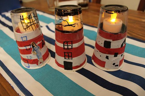 Lighthouses - the ones on this blog are great for a kids' craft.  Then I realized you could do something similar on a more adult scale with tin cans (or pail upside down), glass jars, and craft paint.  You could easily take these from great kids' craft to adult decor item.  Love this idea!