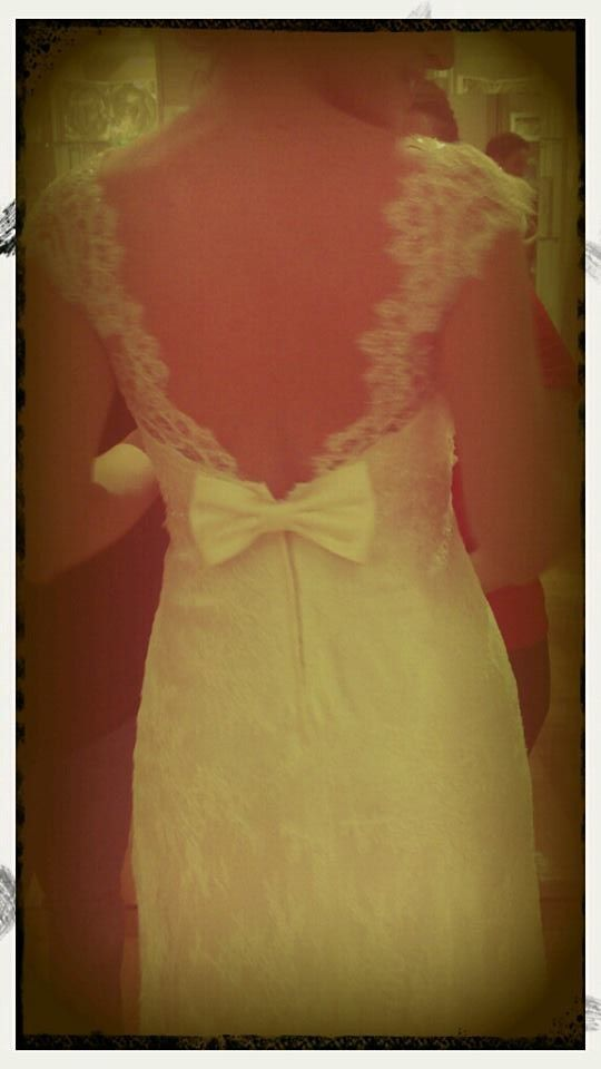 Eleni Kollarou / Lace wedding dress with a beautiful back.