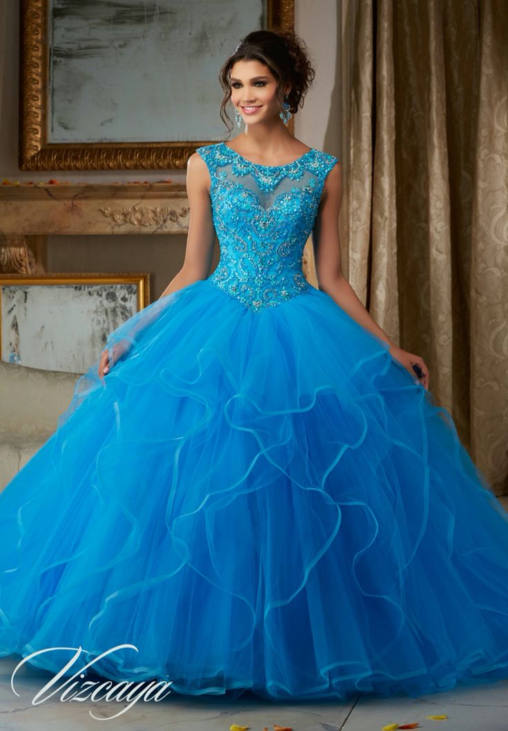 Morilee Vizcaya Quinceanera Dress 89116 PEARL AND CRYSTAL BEADING ON FLOUNCED TULLE BALL GOWN  Matching Bolero Jacket. Available in Champagne/Blush, Peacock/Turquoise, White (Color of this dress): Peacock/Turquoise