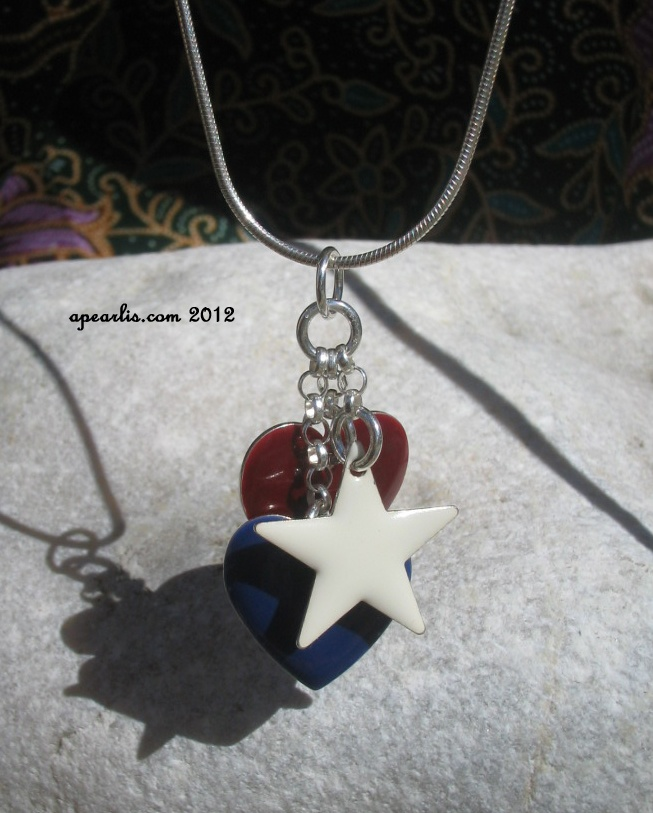 Sterling silver necklace with two hearts and one star in enamel