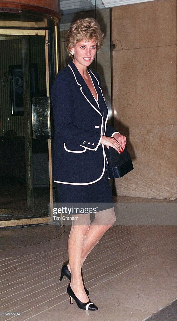 Princess Diana Attending A Charity Lunch At The Hilton Hotel, London. The Princess Is Wearing A Blue Suit Trimmed In White.