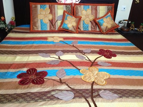 multi coloured, traditional bed cover set from Zafraan. Made of pure silk, this 6-piece set comprises of 1 bed cover,1 comforter,  2 pillow covers and 2 cushion covers.