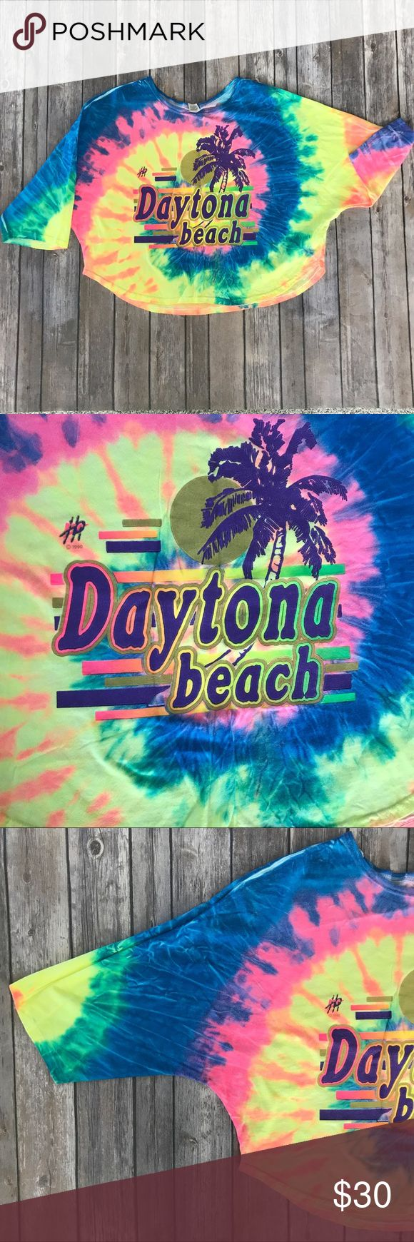 VTG 90s tie Dye crop top festival shirt Daytona Vtg 90s TIE DYE Neon Shirt Crop Top Tee Festival Destin Hippy Womens Made In USA   Excellent condition!  • one size fits most  • Made in USA  • True vintage. Made in 1990 (see photos. On shirt)  • 100% cotton  • No holes, rips or stains  • 3/4 sleeve on the beach Tops Crop Tops