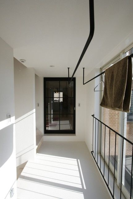 Black railings on white walls | Laundry hanging area | Sunny spot | Double as Potted plant spot