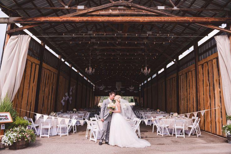 #wedding #barnwedding #reception #bunting #bride #groom #dress #weddingdress #chandeliers #rustic #vintage #KevinTrowbridge