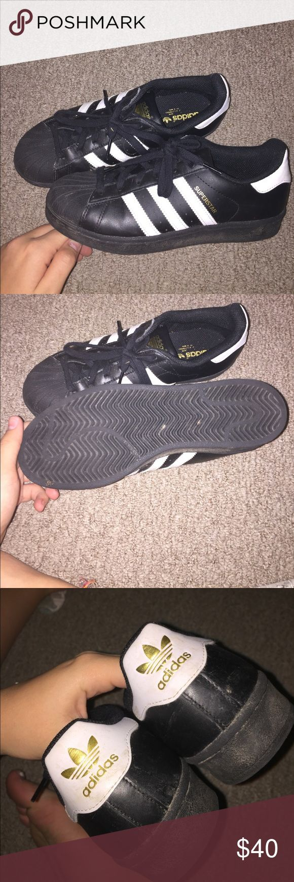 black adidas superstars super cute! i will clean them before shipping. i bought from another posher but they are too big:/ super cute and in awesome condition. they say size 7 but euro 38.5 adidas Shoes Athletic Shoes