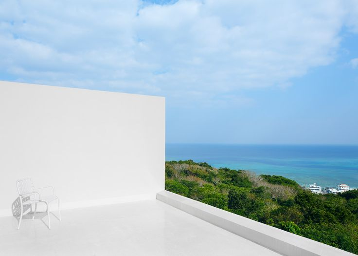 John Pawson creates bright white holiday home on Okinawa, with a roof terrace that faces the sea