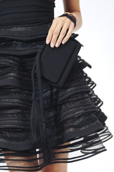CoCo is Haute - sassy black dress.  The skirt is layers of sheer silk ruffles with rows of cording accent.  Both retro and forward in its design.