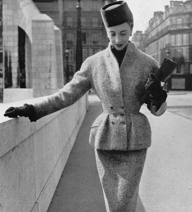 Marie-Thérèse in nubby wool green and gray tweed suit, jacket has two pleats that round out the hips, by Jeanne Lafaurie, photo by Pottier, 1951