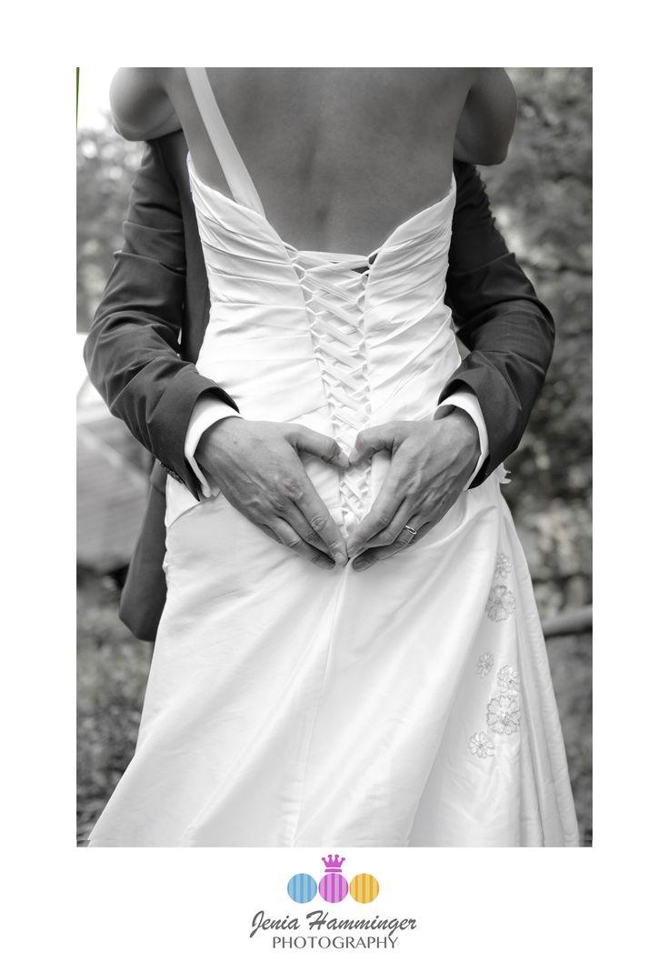 A hidden sign of love behind bride's back