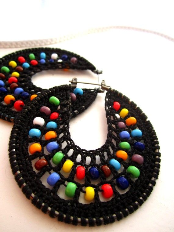 Hand made crocheted hoops. The interior panel is knitted with a very light black thread and mixed colour beads within the web.  They are