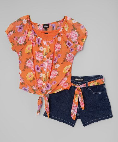 Create an instant outfit for your little one with this charming set that includes shorts made from stretchy materials.