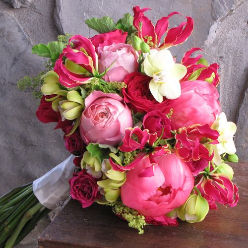 "bridal bouquet with David Austin ""Darcey"" garden roses, Hot Majolika spray roses, gloriosa lilies, Coral Charm peonies, Romantic Antike garden roses, green mini cymbidium orchids, green Phalaenopsis orchids, alchemilla and scented geranium"