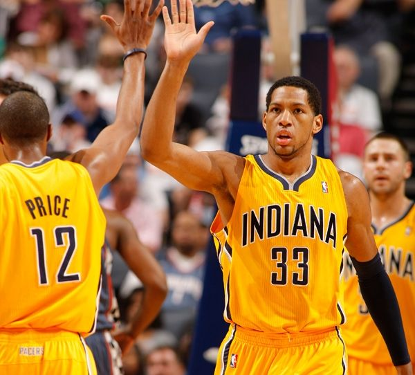 Danny Granger #33 of the Indiana Pacers celebrates a shot against the Charlotte Bobcats on March 23, 2011 at Time Warner Cable Arena in Charlotte, North Carolina.