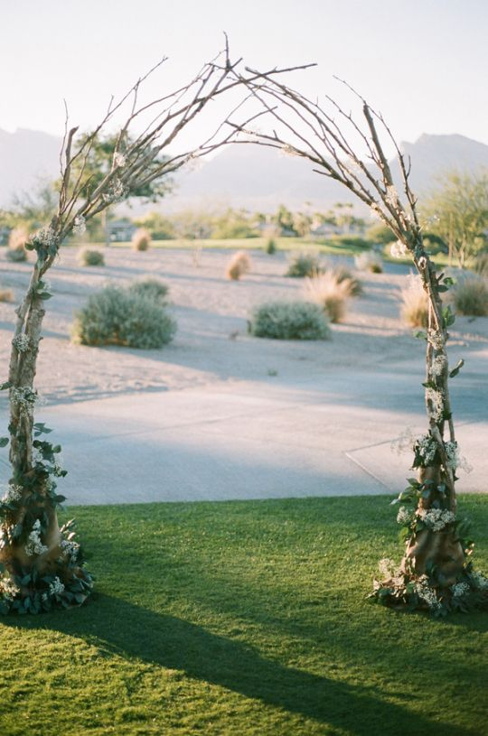 The groom DIY'd this arch, which the couple married under | vintage Vegas wedding with gorgeous florals | Gaby J Photography