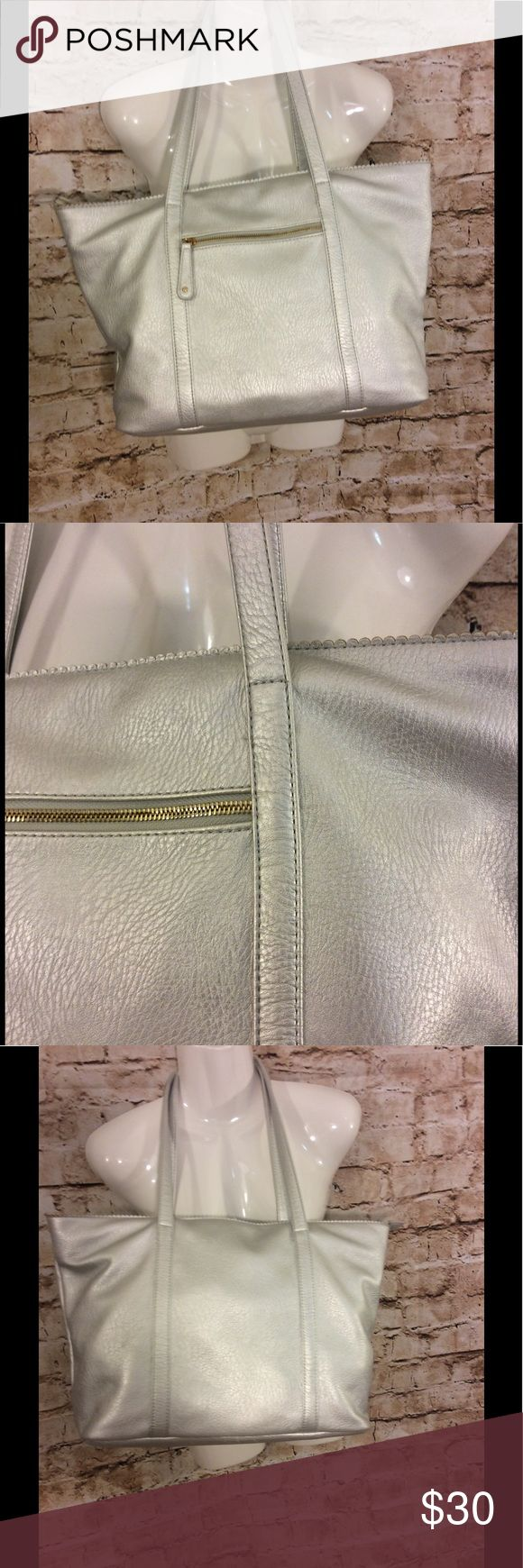Street-level large silver tote/shoulder bag Good very gently used condition street-level large silver coat/shoulder bag Front pocket with gold tones zipper Large inside compartment Smaller zipper pocket inside Two smaller open pockets inside Black with a diamond shape detail inside Cloth lining No nicks or damage to Tote/purse  very clean condition Height of bag is approximately 12 inches Width of bag  is approximately 14 inches Depth of bag is approximately 6 1/4 inches Height of strap is…