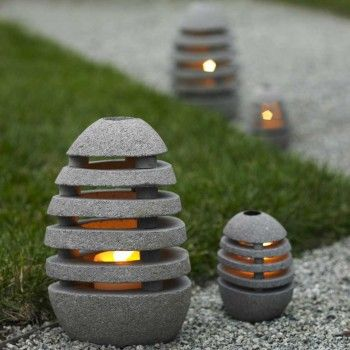 Stone Egg Lantern - Slotted to illuminate in all directions, these oval stone lanterns open so you can insert a tealight or votive candle (not included), depending on the size. $32.00