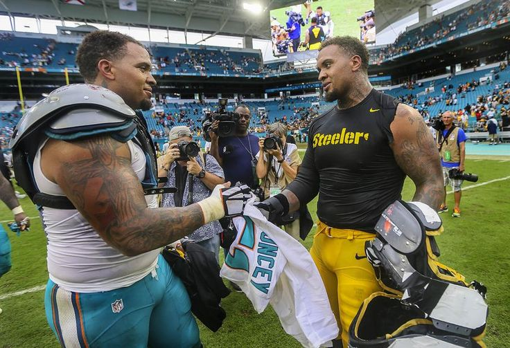 Steelers vs. Dolphins:     October 16, 2016  -  30-15, Dolphins  -      Miami Dolphins center Mike Pouncey (51), exchanges his jersey with his twin brother Pittsburgh Steelers center Maurkice Pouncey (53), after the Dolphins defeated the Steelers during their NFL game Sunday October 15, 2016 at Hard Rock Stadium in Miami Gardens. (Bill Ingram / The Palm Beach Post)