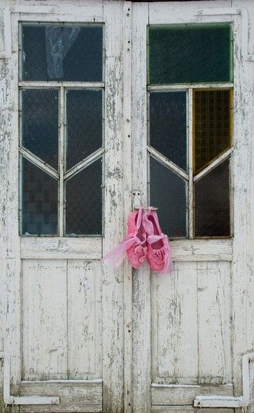 White door and pink shoes