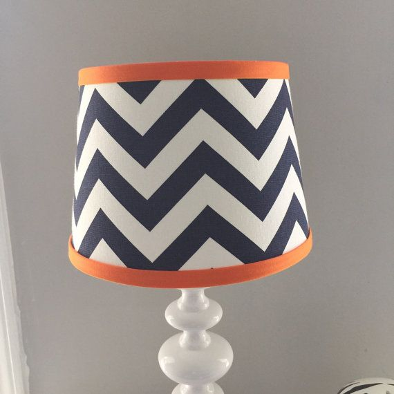New modern design! Custom lamp shades available to match your Baby Milan bedding or any decor. Lamp shade has an opening that lays on top of the base. Fits most standard lamp base.  -8 Top x 10 Bottom x 7 Height -Navy and chevron print with accent orange trim -Drum style with uno fitter -Listing for shade only   Dont see your color? Select custom and add your custom color during checkout.