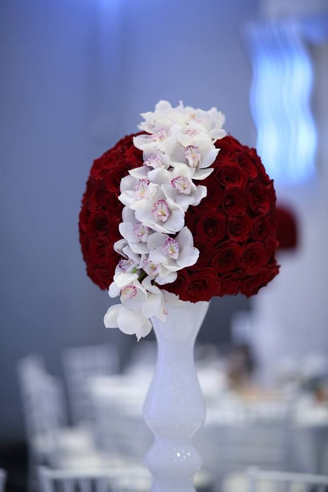 Gorgeous red roses with delicate white cymbidium orchids
